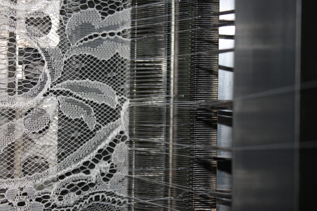 lace swath coming out of a leavers machine